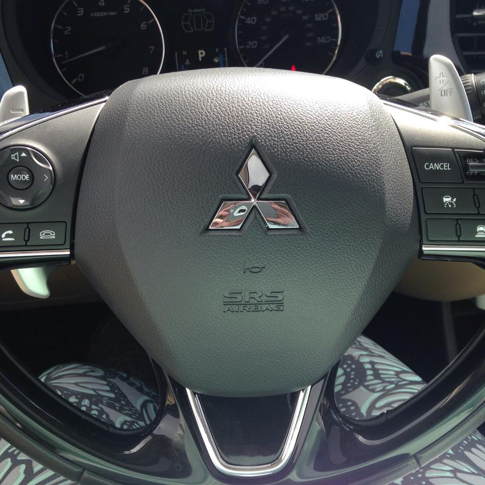 The 2016 Mitsubishi steering wheel allows you to tap into the communication system. This includes Bluetooth controls including a voice command option. The audio remote control buttons allow you to easily adjust your volume as needed or change stations. On the right hand side you have the cruise control settings.